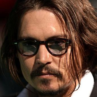 Alice In Wonderland, starring Johnny Depp, is No 1 in the US