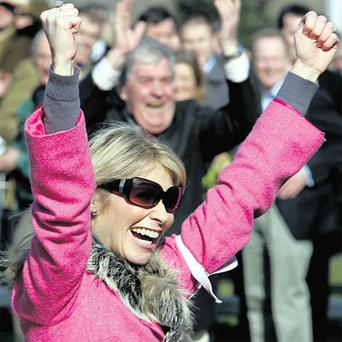 Heather de Bromhead, from Wexford, cheers after Sizing Europe, trained by her husband Henry, won the Irish Indpendent Arkle Chase