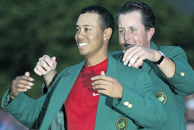 Tiger Woods had plenty to smile about in 2005 when being presented with the Green Jacket by Phil Mickelson at Augusta. The world number one is poised to return to action at The Masters next month