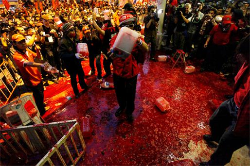 Supporters of former Thai prime minister Thaksin Shinawatra pour human blood at government HQ yesterday