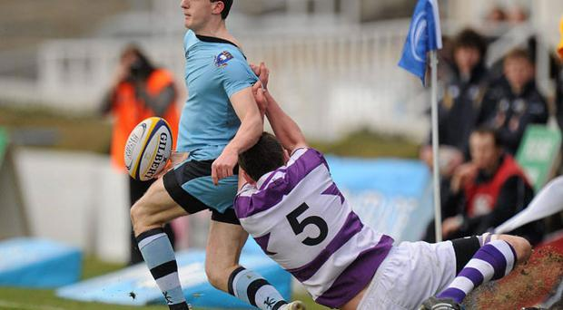 Clongowes captain Robert Hynes tackles St Michael's Mark Corballis during yesterday's Leinster Senior Schools Cup final at the RDS PAT MURPHY / SPORTSFILE