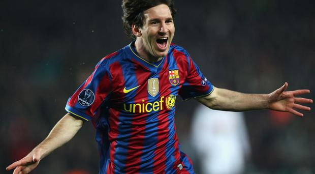 Lionel Messi celebrates after scoring the first of his two goals in Barcelona's 4-0 victory over Stuttgart at the Nou Camp last night Photo: Getty Images