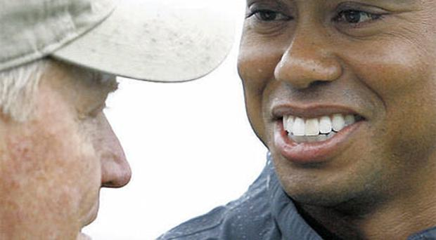 Tiger Woods and Jack Nicklaus laugh on the tee during the Memorial Skins Game at Muirfield Village last June