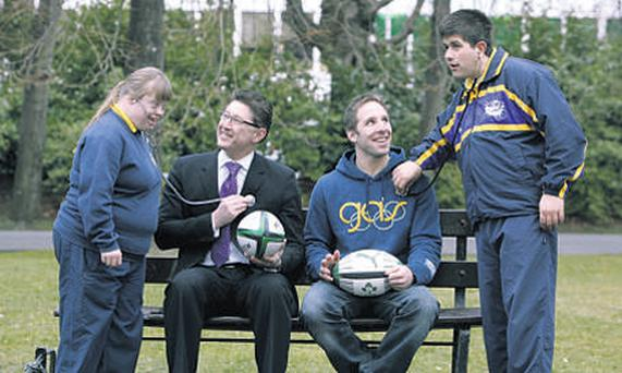 Eamonn Clifford and Amy Quinn from Bray Lakers Athletics Club do a check-up on Liam FitzGerald, chief executive of United Drug, and rugby international Tomas O'Leary, at the announcement of the partnership with United Drug as official supplier to the 2010 Special Olympics Ireland Games