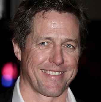 Hugh Grant apparently got smeared in chocolate cake during a row at a party
