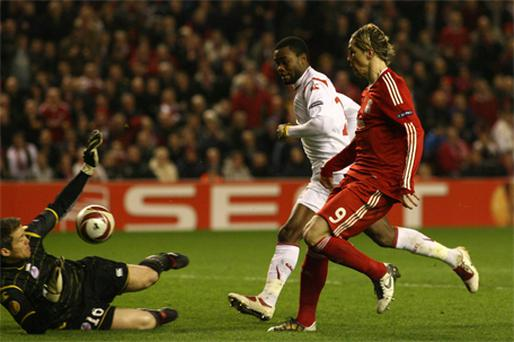 Fernando Torres flicks the ball over Lille goalkeeper Mickael Landreau to score Liverpool's second goal at Anfield last night