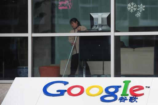 A cleaning lady mops the floor inside the Google China headquarters building in Beijing on January 14. Photo: Getty Images