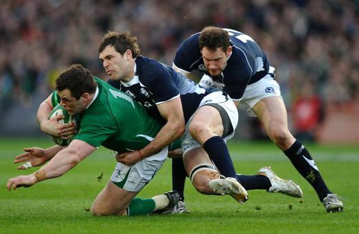 DUBLIN, IRELAND - MARCH 20: Cian Healy of Ireland is tackled by Sean Lamont and Graeme Morrison of Scotland during the RBS Six Nations match between Ireland and Scotland at Croke Park on March 20, 2010 in Dublin, Ireland. (Photo by Laurence Griffiths/Getty Images)