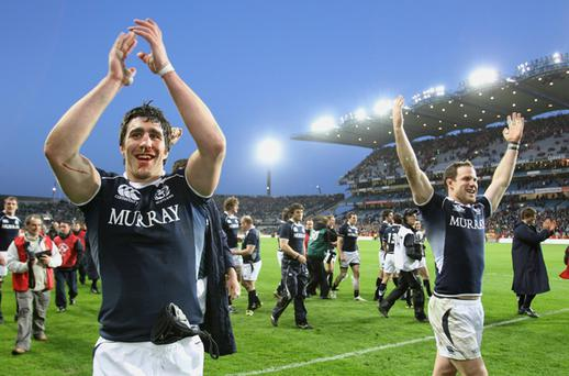 Kelly Brown and Graeme Morrison of Scotland celebrate victory at the close of the match