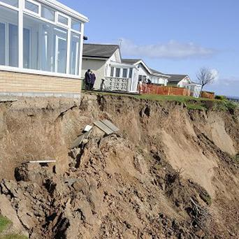 Artist Kane Cunnigham's house is at the mercy of cliff erosion at Knipe Point, near Scarborough
