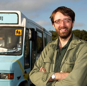 Andy Pag has been fined for using a mobile phone in India while driving around the world in a vegetable oil powered bus