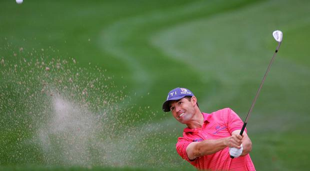 Padraig Harrington hits his third shot on the first hole from a bunker during the final round of the Transitions Championship in Tampa. Photo: Getty Images
