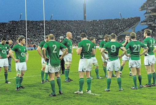 The Irish players are left dejected on Croke Park after losing the last scheduled rugby international in the stadium to Scotland on Saturday