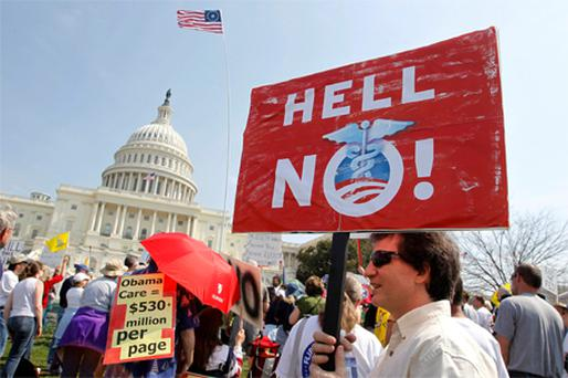 Opponents of President Obama's healthcare bill rally outside the US Capitol building in Washington yesterday