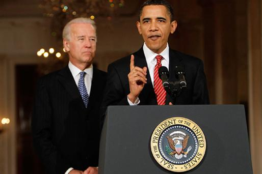 US President Barack Obama speaks as Vice President Joseph Biden listens at the White House after the House of Representatives passed the health care reform legislation. Photo: Getty Images