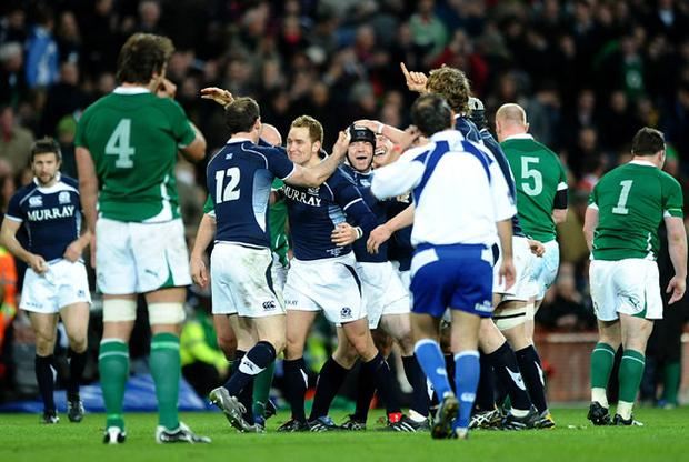 A dejected Donncha O'Callaghan looks on as Scotland celebrate. Photo: Getty Images