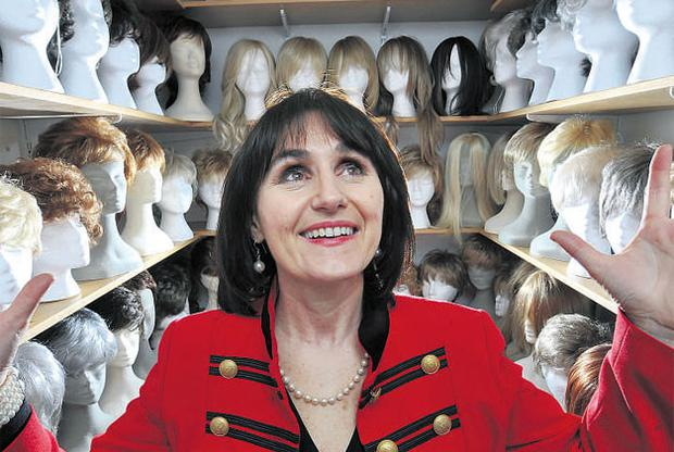 Sounding board: Therese Hughes in her Belfast shop. 'We wanted to provide more than a wig-fitting service. We wanted to provide advice and support and someone to talk about hair loss.' PHOTO: CHARLES MCQUILLAN