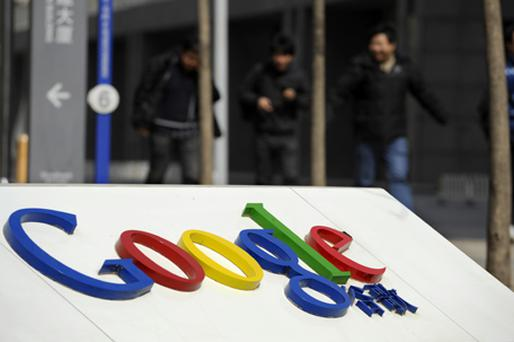 People walk near the Google China headquarters in Beijing. Photo: Getty Images