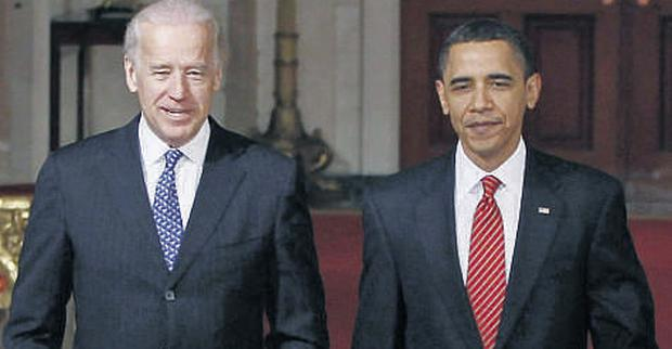 President Obama with vice-president Joe Biden in the White House after the healthcare legislation was passed by the House of Represen