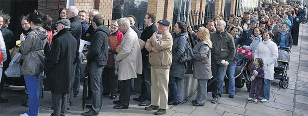 People queued outside the Passport Office on Molesworth Street in Dublin yesterday