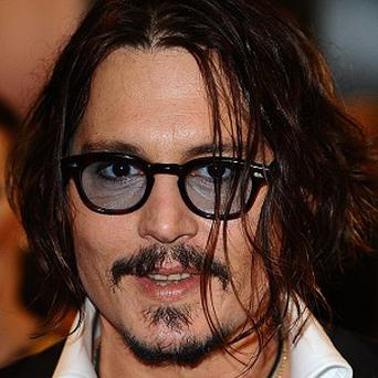Johnny Depp's movie Alice In Wonderland is flying high at the US box office