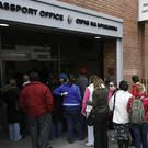 People queued outside the Passport Office on Molesworth Street in Dublin. Photo: PA