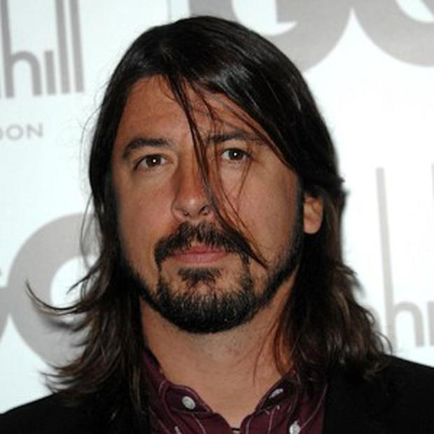 Dave Grohl plays drums on a track on Slash's album