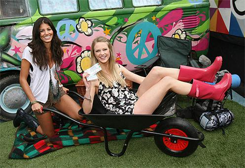 Models Martha Christie (left) and Niamh Healy were at the POD night club in Dublin to help unveil the line-up for this year's Electric Picnic. Photo: PA