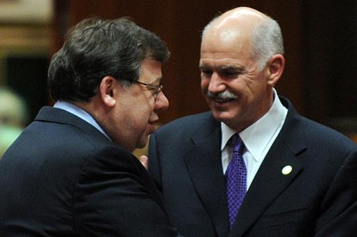 Taoiseach Brian Cowen talks with Greek Prime Minister George Papandreou at the summit. Photo: Getty Images