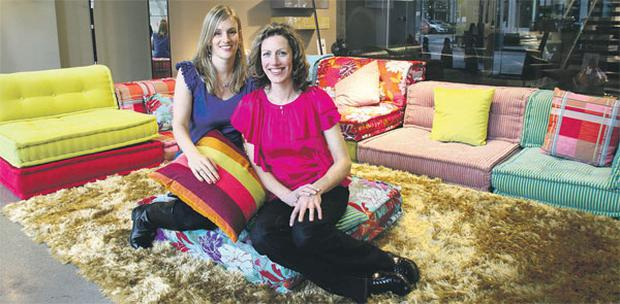IDEAL HOME: Catherine Crowe (left) and Denise O'Connor of Optimise Design, in front of the Mah Jong sofa by Kenzo, available from Roche Bobois. Pic taken at Roche Bobois showrooms in Sandyford, D18.