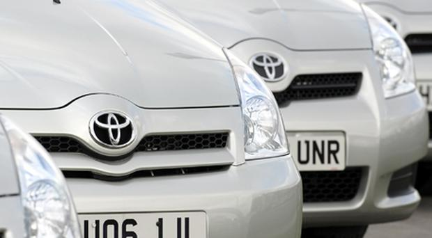 Toyota: Sales dip forces production cuts