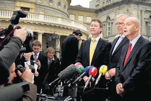 IN LIKE PLINTH: New Government Chief Whip John Curran, centre, and newly appointed ministers Tony Killeen and Pat Carey face the media on the famous plinth of Leinster House after the cabinet reshuffle last week. Photo: Gerry Mooney