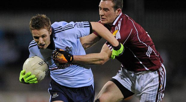 Dublin's Alan Hubbard is tackled by Damien Burke of Galway during their NFL match at Parnell Park on Saturday night DÁIRE BRENNAN / SPORTSFILE