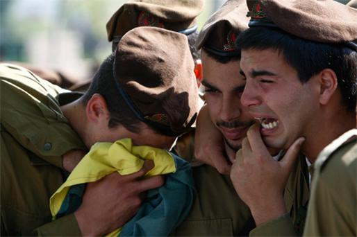 Israeli soldiers mourn during the funeral of Ilan Sviatkovsky in Rishon Letzion, near Tel Aviv, yesterday. Sviatkovsky was one of two soldiers killed during a clash with Hamas gunmen on Friday