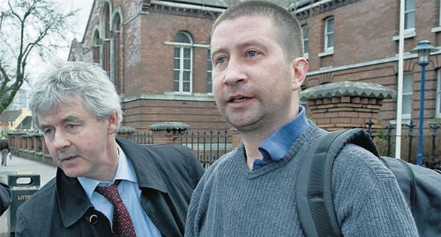 Garda Mario Boersma (right) with his solicitor Frank Buttimer at Cork District Court yesterday