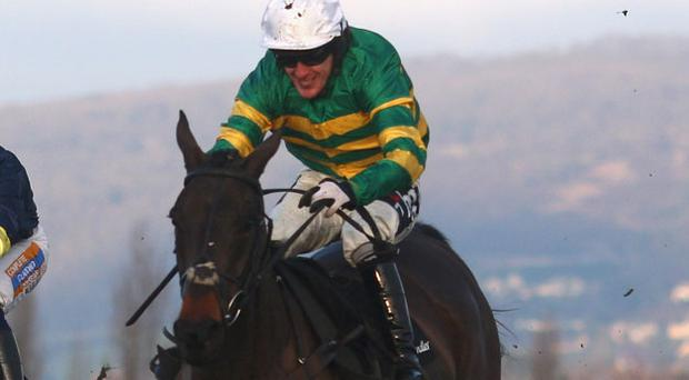 Tony McCoy partnering Can't Buy Time to victory at Cheltenham on New Year's Day. According to the bookies, the record-breaking jockey will ride the JP McManus-owned gelding in next month's Aintree Grand National. Photo: Getty Images