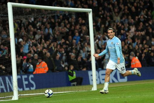 Manchester City's Carlos Tevez completes his hat-trick during the Premier League clash with Wigan Athletic at the City of Manchester Stadium last night