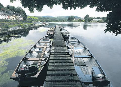 Lough Derg has plenty to offer visitors, including a day-long sailing course on the lake, above, and windsurfing