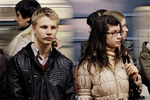 Commuters stand at Park Kultury metro station in Moscow yesterday