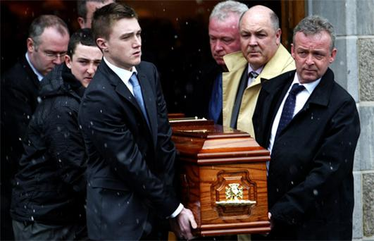 The coffin of the coffin of John Healy is carried by relatives including son Mark