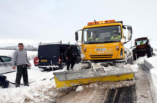 A snow plough attempts to clear the thick layer of snow on the Glenshane Pass