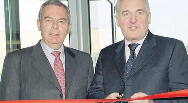 Quinn Group founder Sean Quinn with then Taoiseach Bertie Ahern at the opening the group's Q Centre, in Blanchardstown, in 2004