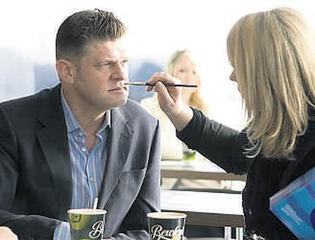 Grumpy Brendan O'Connor gets a smile painted on