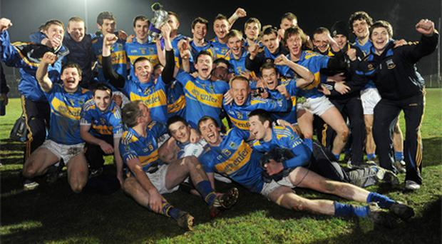 The Tipperary team celebrate with the trophy following their victory over Kerry in Wednesday's Cadbury Munster U21 football final