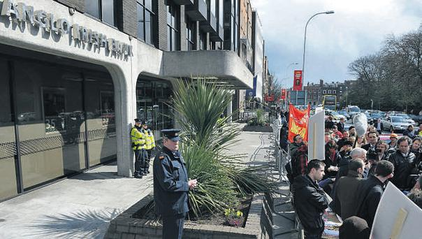Joe Higgins MEP addresses a small crowd of protesters outside Anglo Irish Bank HQ in Dublin yesterday