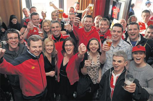 Munster supporters toast the lifting of the Good Friday drinking ban in Clohessy's bar in Limerick yesterday evening