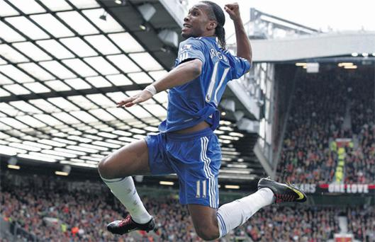 Chelsea substitute Didier Drogba celebrates after scoring what proved to be the winning goal against Manchester United yesterday