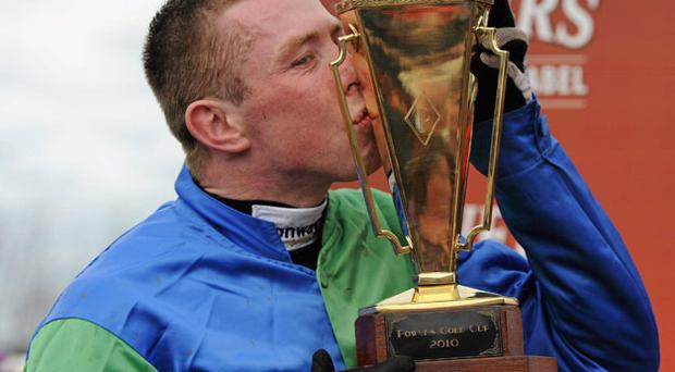 Andrew Lynch kisses the Powers Gold Cup after his success aboard Jadanli