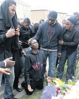 Mourners gathered at the spot in Tyrrelstown, west Dublin, where Toyosi 'Toy' Shittabey died. Photo: Gareth Chaney