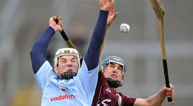 Liam Rushe of Dublin and Galway's Donal Barry battle for possession